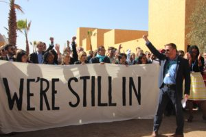 "US attendees of the 2016 United Nations Climate Change Conference in Marrakech, Morocco say ""we're still in and fighting for climate justice"" Photo: John Englart (Takver)"